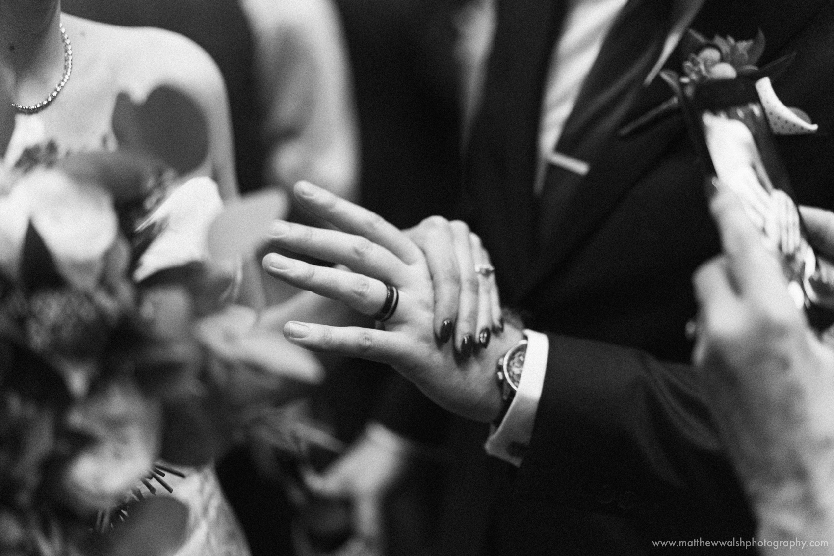 The newly wed couple show off their wedding rings to an emotional yet happy guest