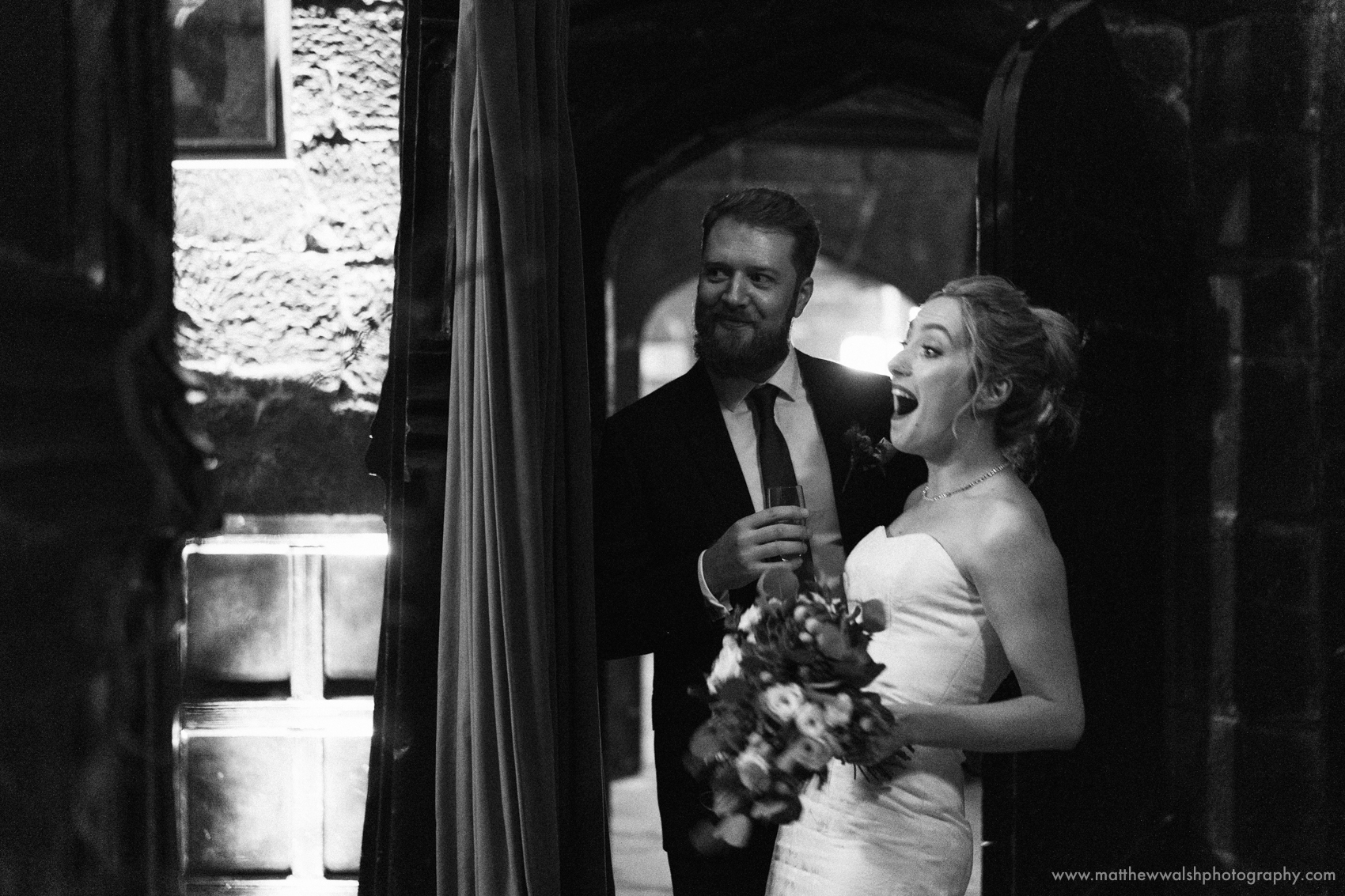 The bride certainly finds something funny