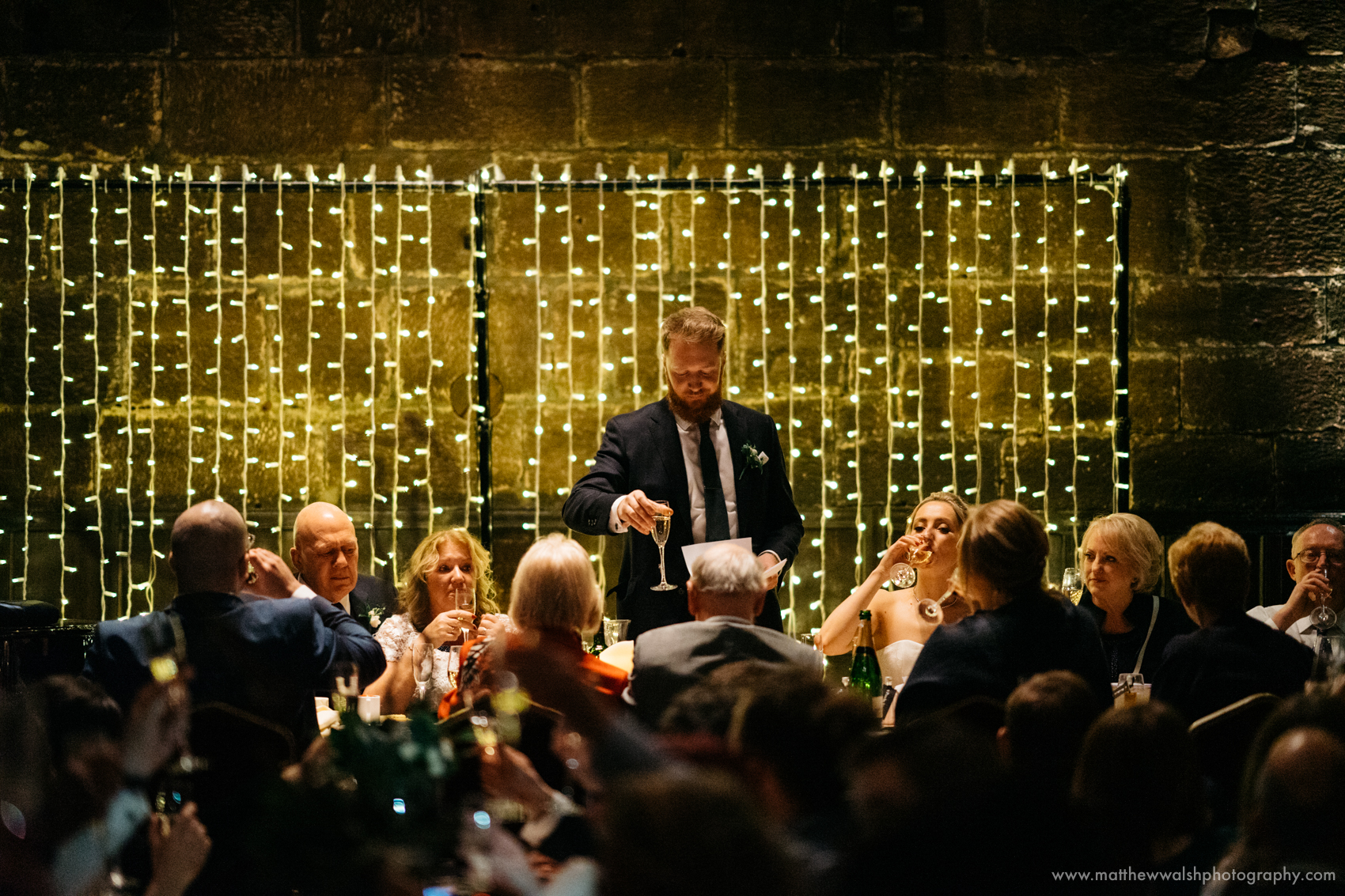 The groom makes a toast to his lovely new wife