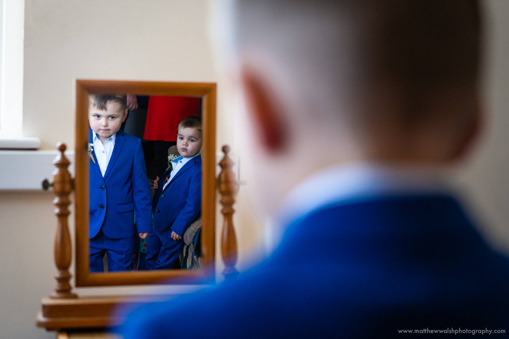 I love this image, depth created by the out of focus foreground and use of reflections to show the two boys together