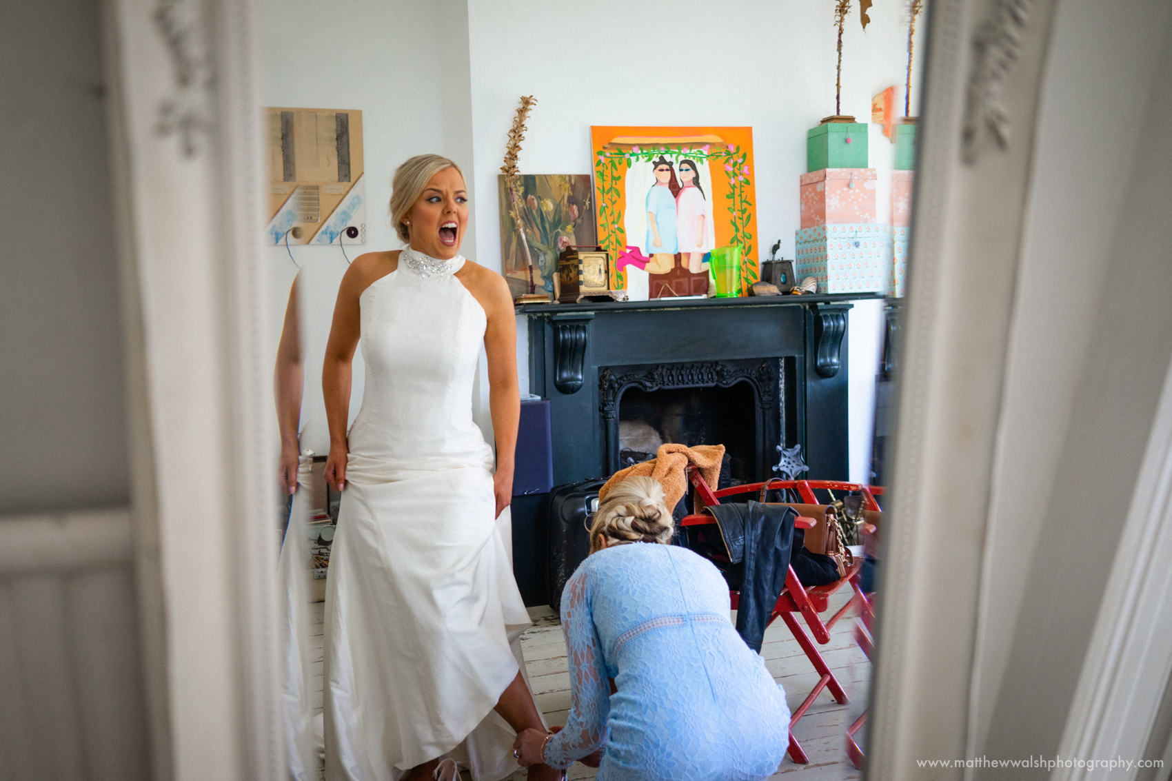 A real documentary style moment as the bride shoes are tightened too tight
