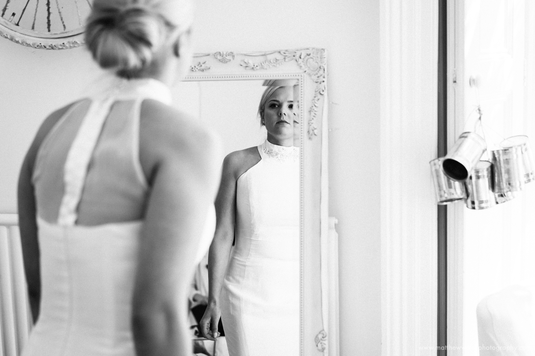 Bride almost ready checking herself in the mirror