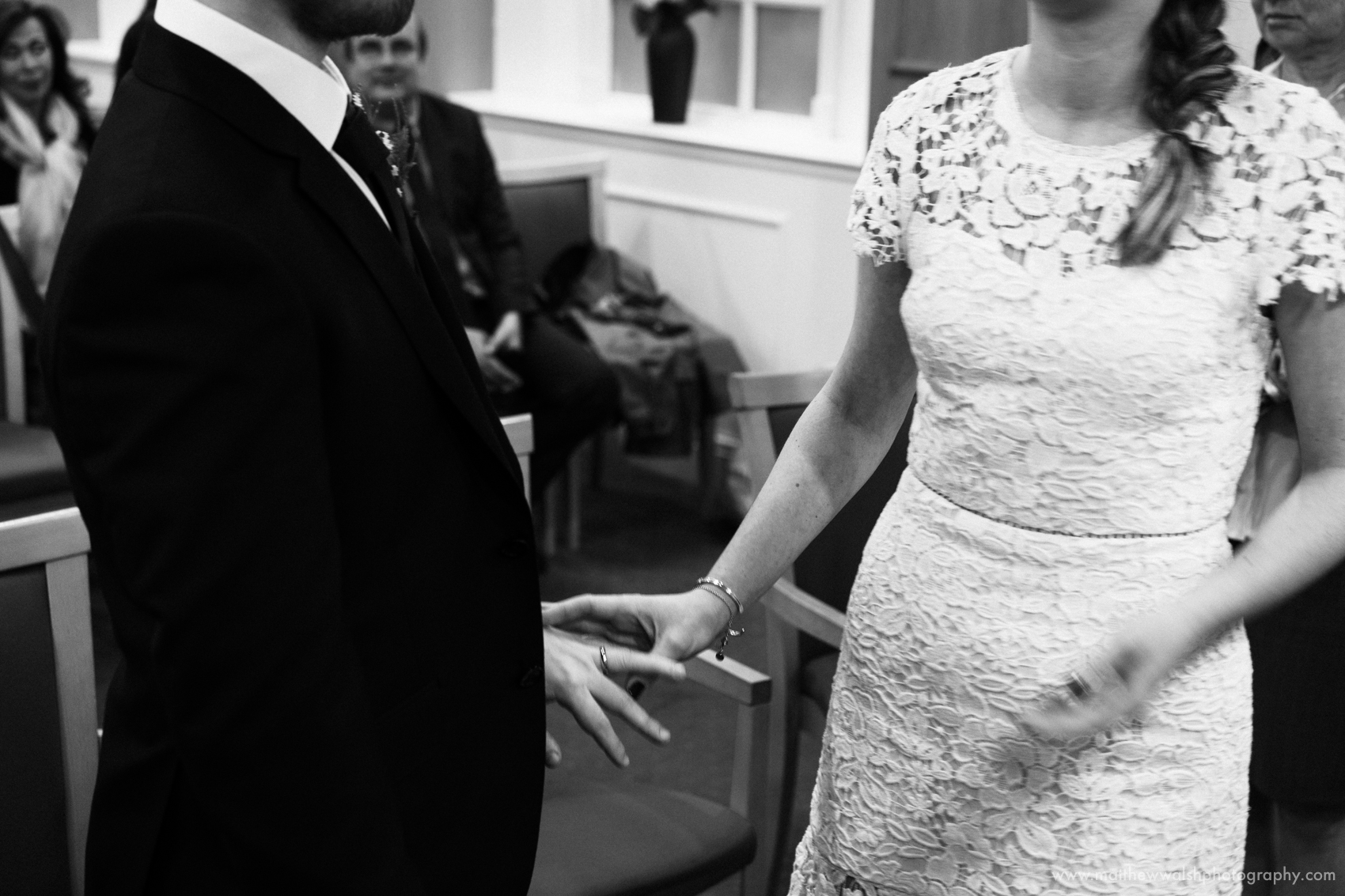 The exchange of rings during the civil ceremony at Manchester Registry office