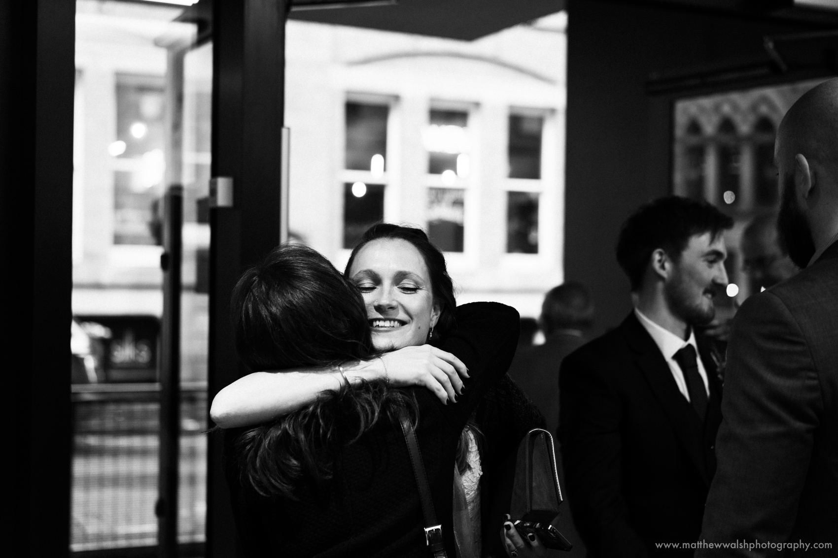The bride hugs her oldest and best friend