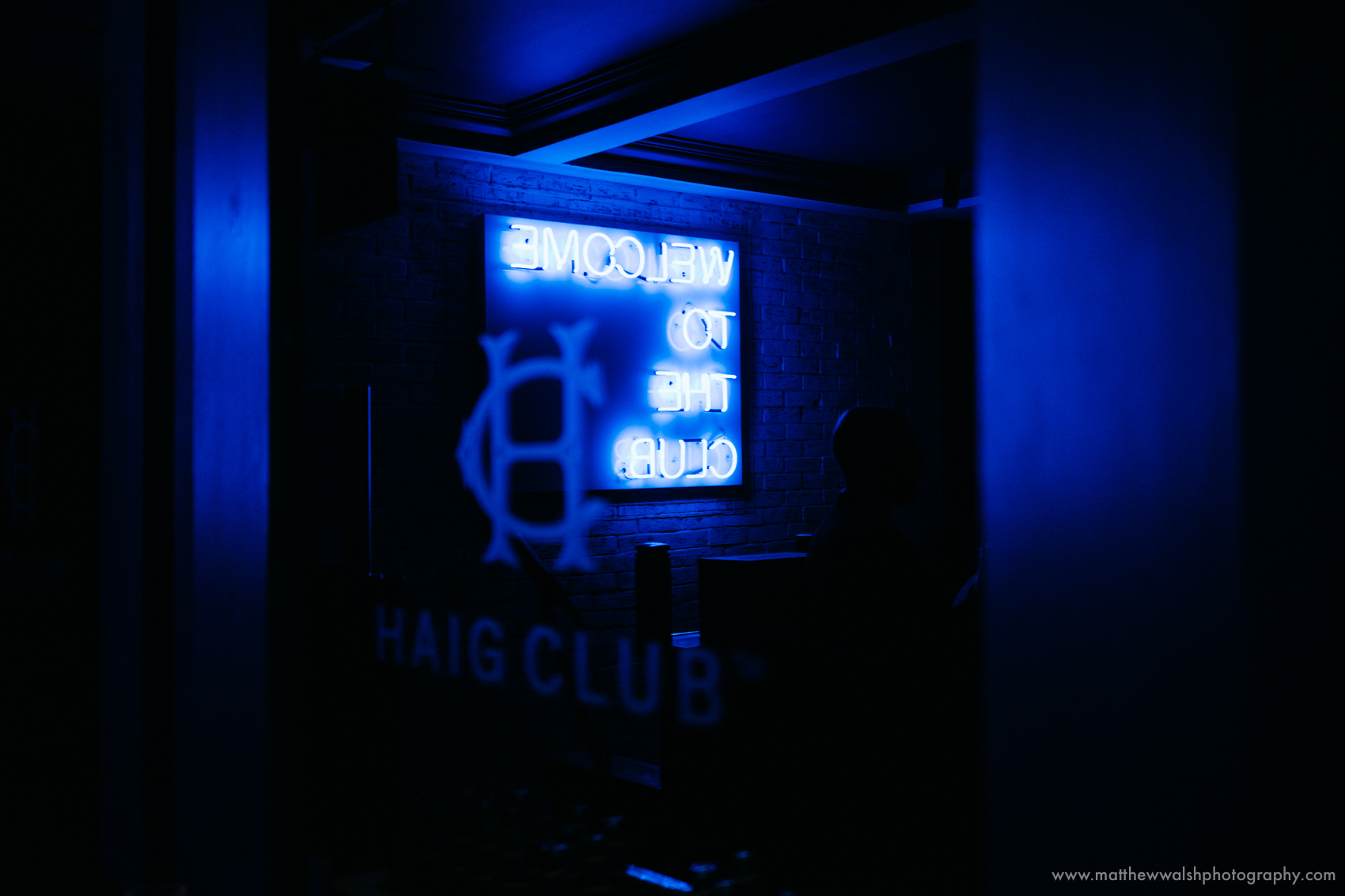 Welcome to the club - neon sign for the Haig Club Manchester