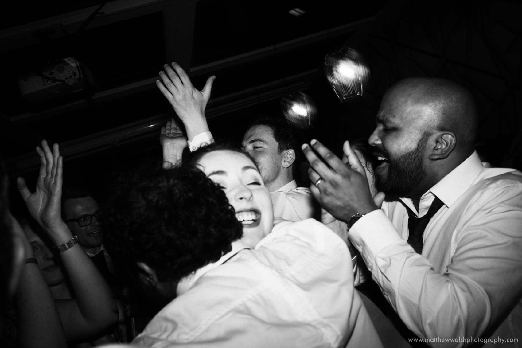 Guests dancing and hugging at an alternative wedding reception at the Living room in Central Manchester