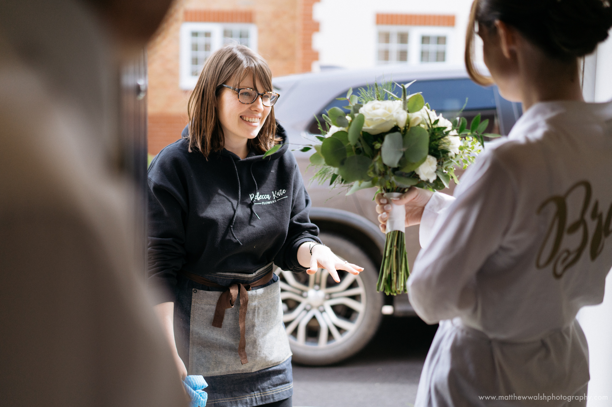 The florist Rebecca Kate Flowers arrives with the brides bouquet and other flowers