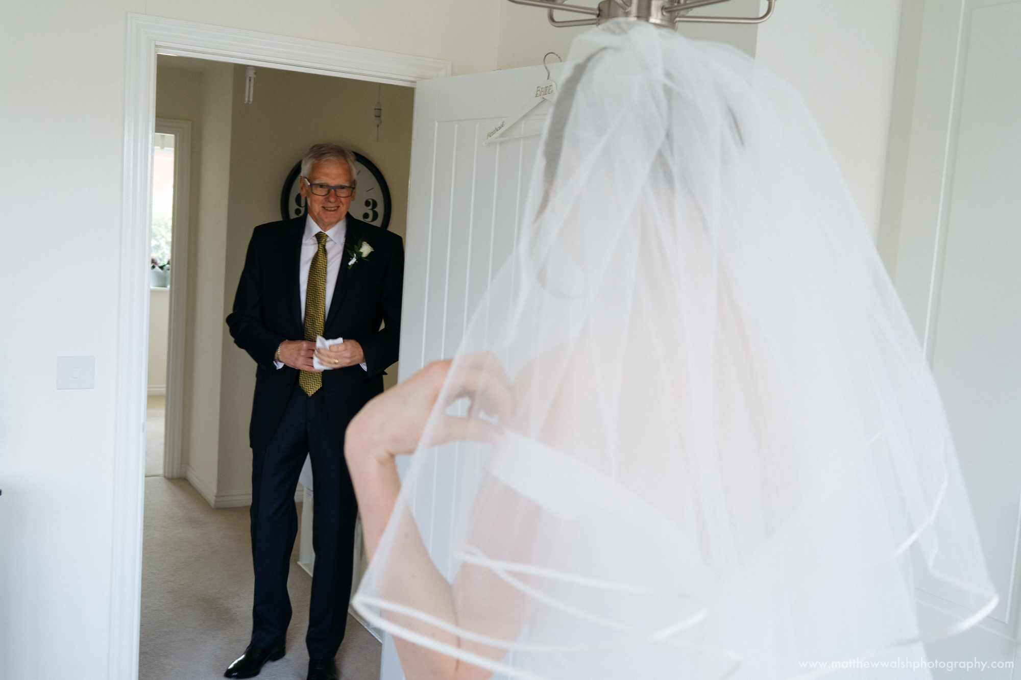 The first look as the father of the bride sees his daughter in her wedding dress for the first time