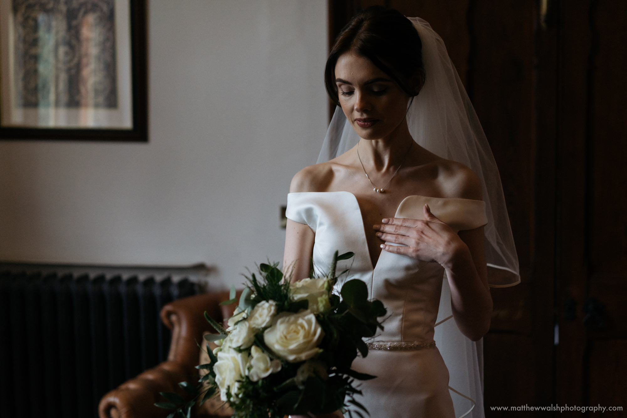 The bride looking beautiful with a little window light