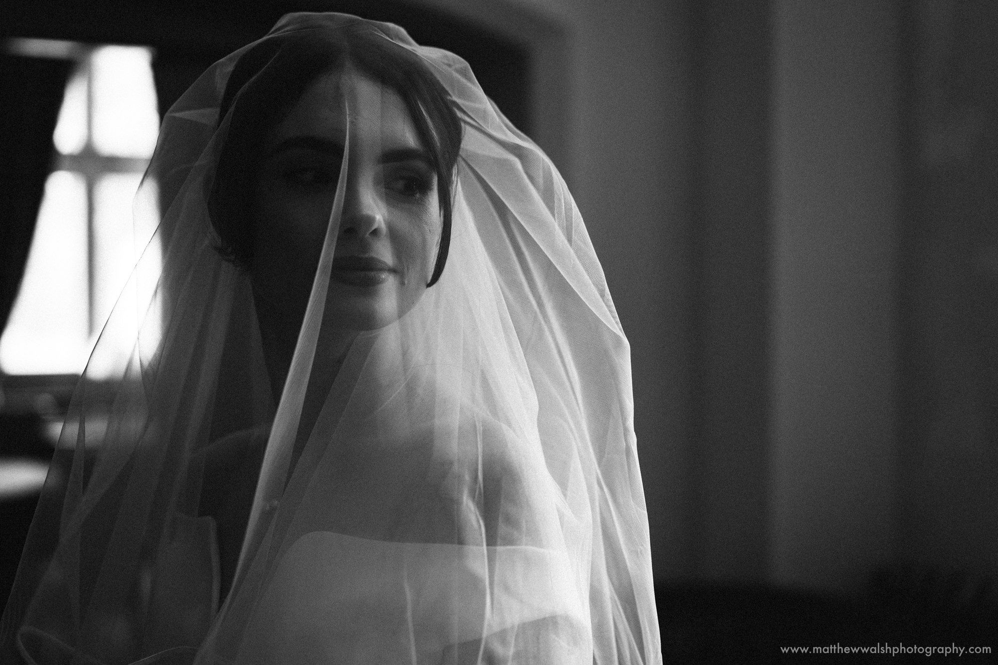 The bride in her veil about to walk down the isle