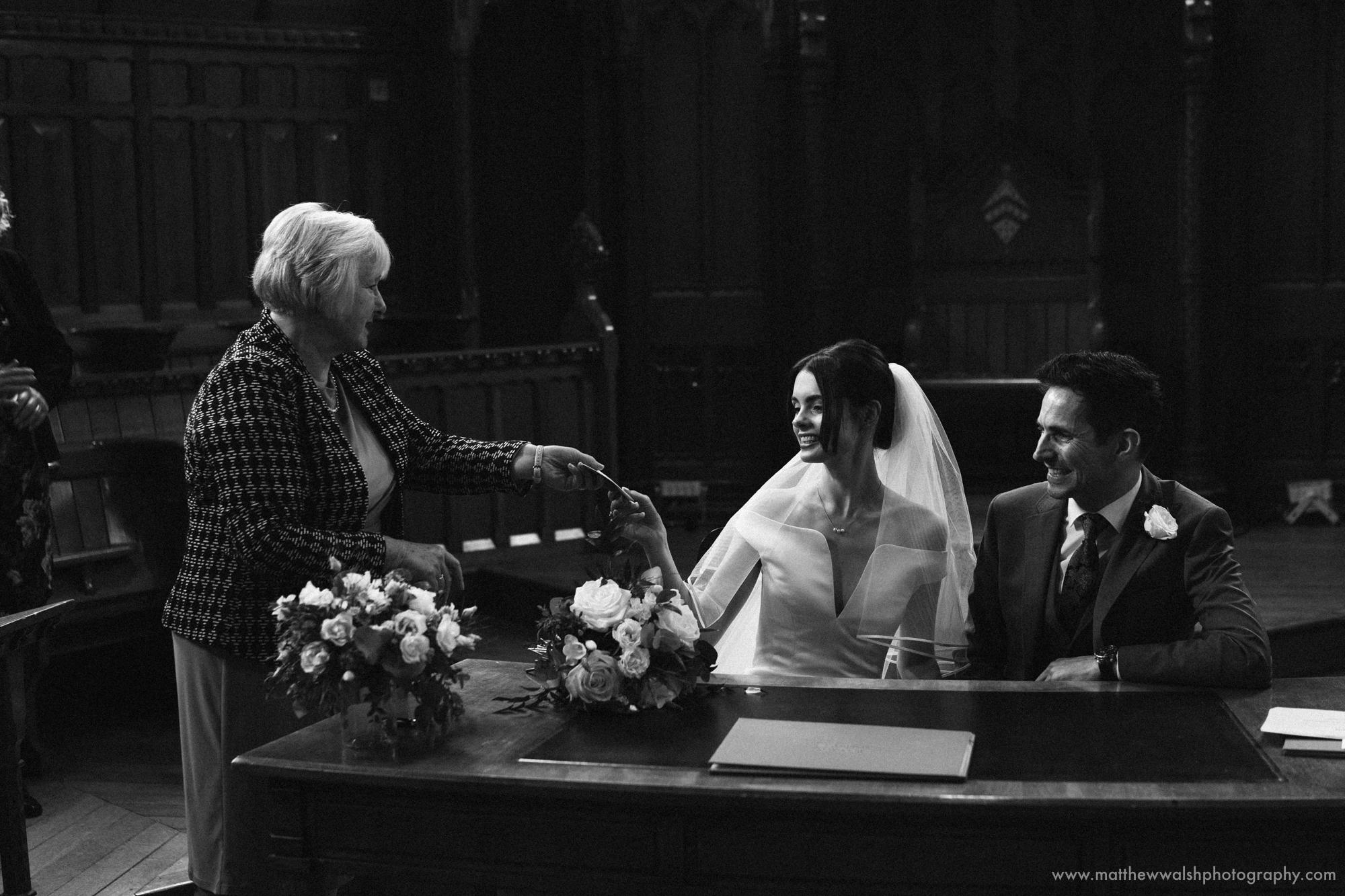 Handing over the marriage certificate