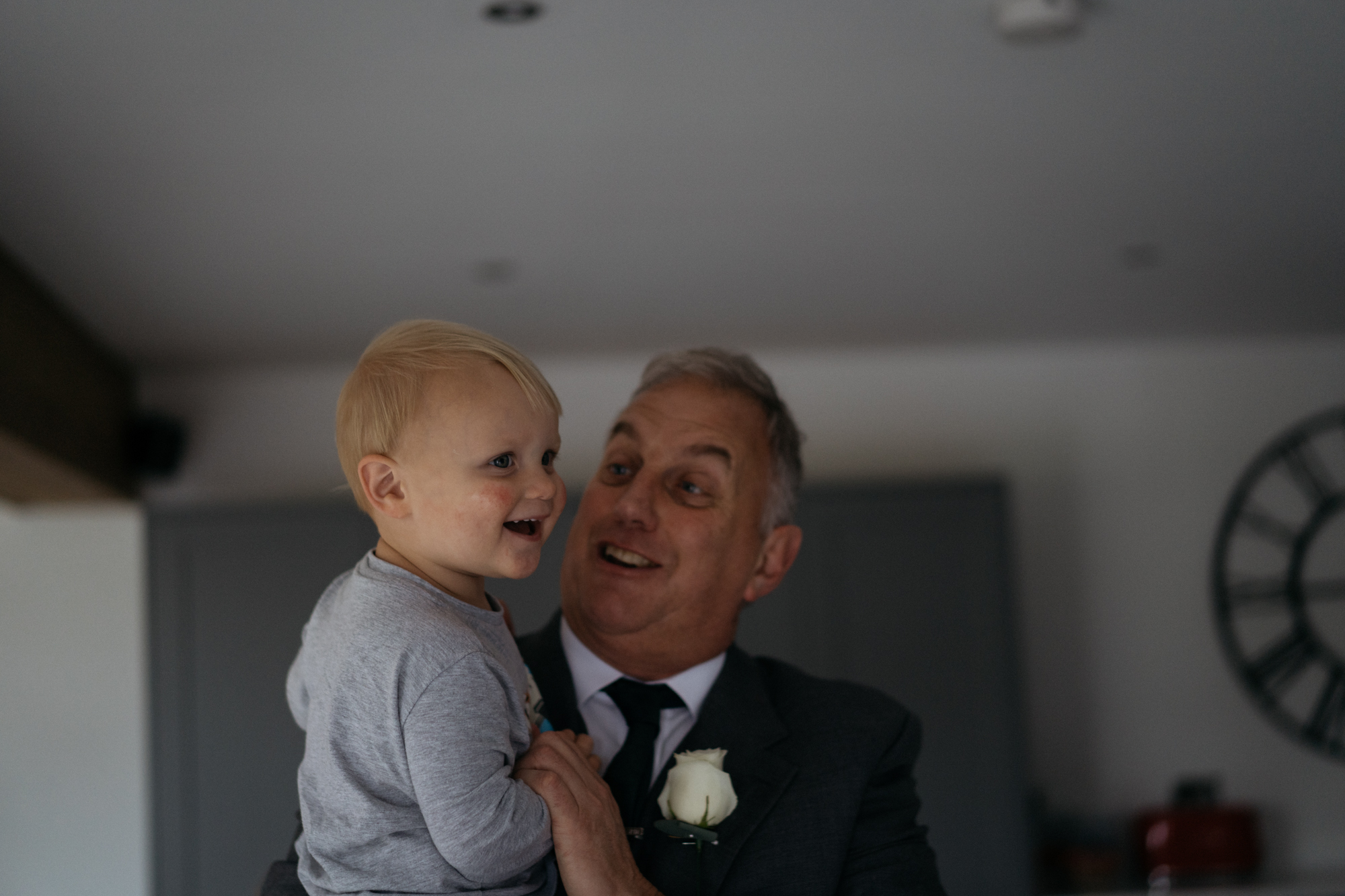 A little boy happy to be with his grandfather