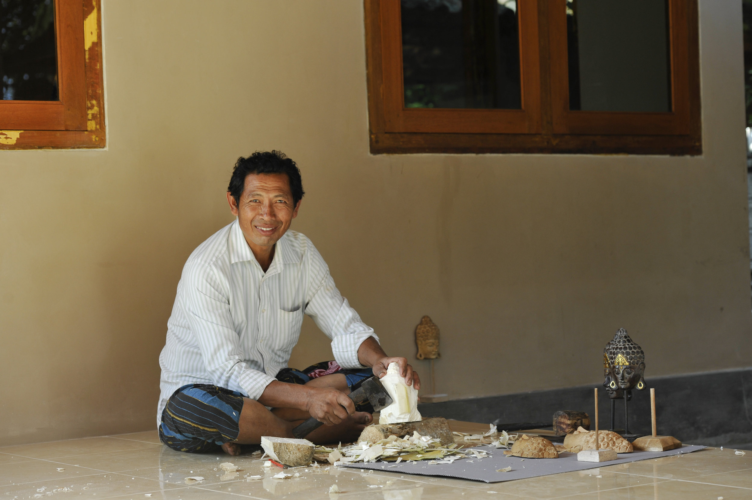 I Made Muluh is a master wood carver, and now six other craftspeople in his district.