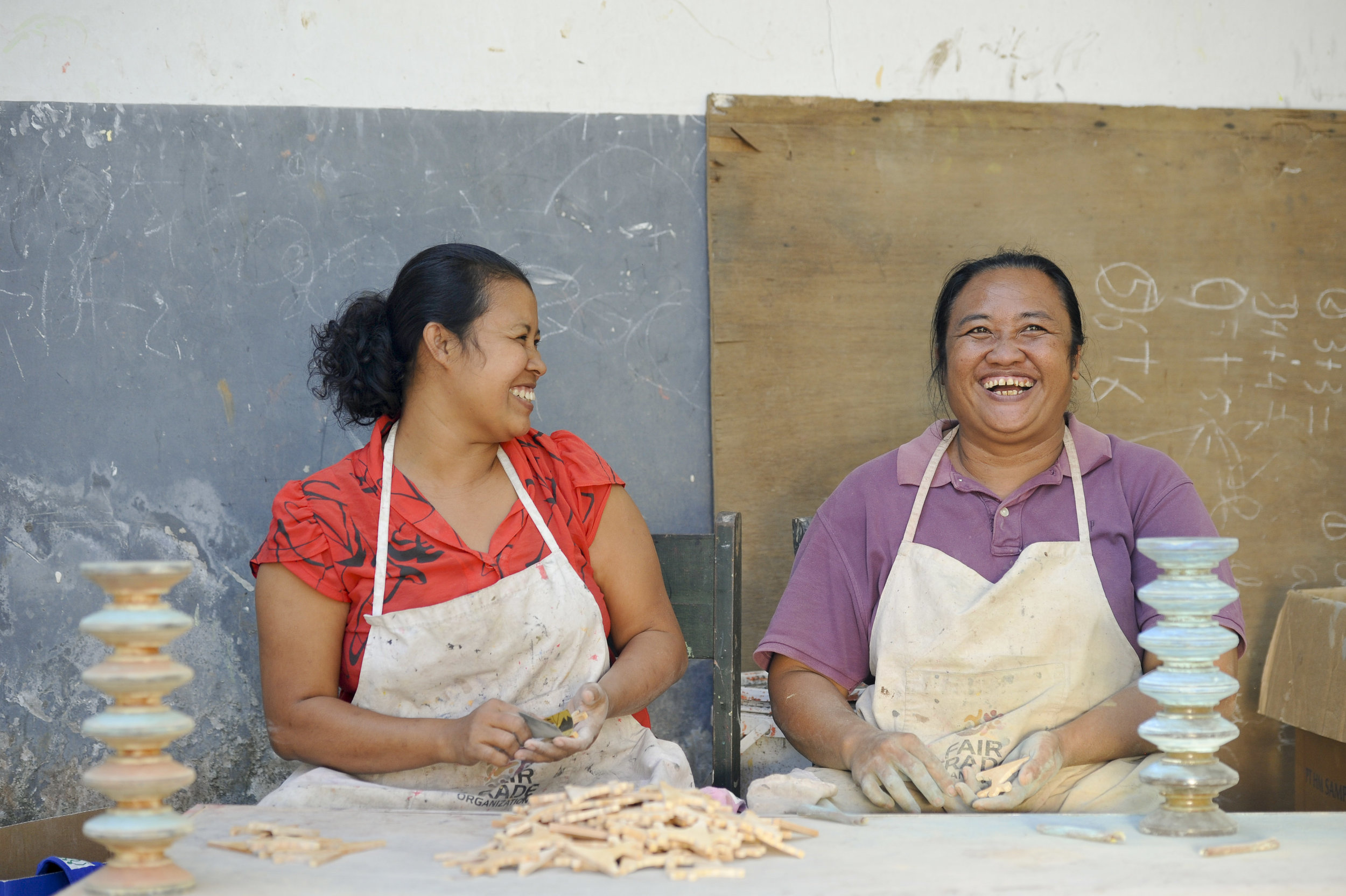 Wayan Marni Penath and Ketut Suter share a joke during a work break from sanding products sold by Oxfam fair trade partner   Mitra     Bali