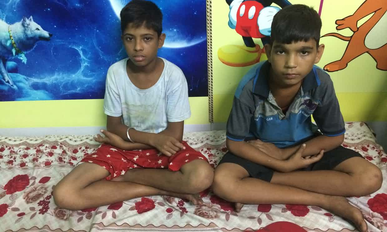 "Two boys rescued from Sealdah's platforms are housed in a ""child friendly"" police station before they are reunited with their families. Photograph: Mark Townsend"