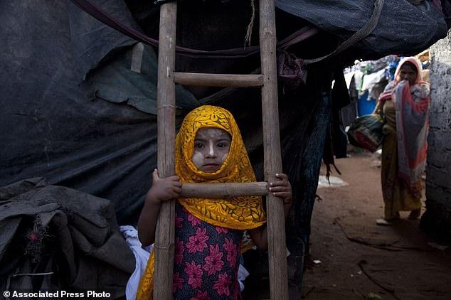 1366569-4897570-A_Rohingya_Muslim_girl_Yasmin_Ara_stands_in_front_of_her_shanty_-a-1_1505850699008.jpg