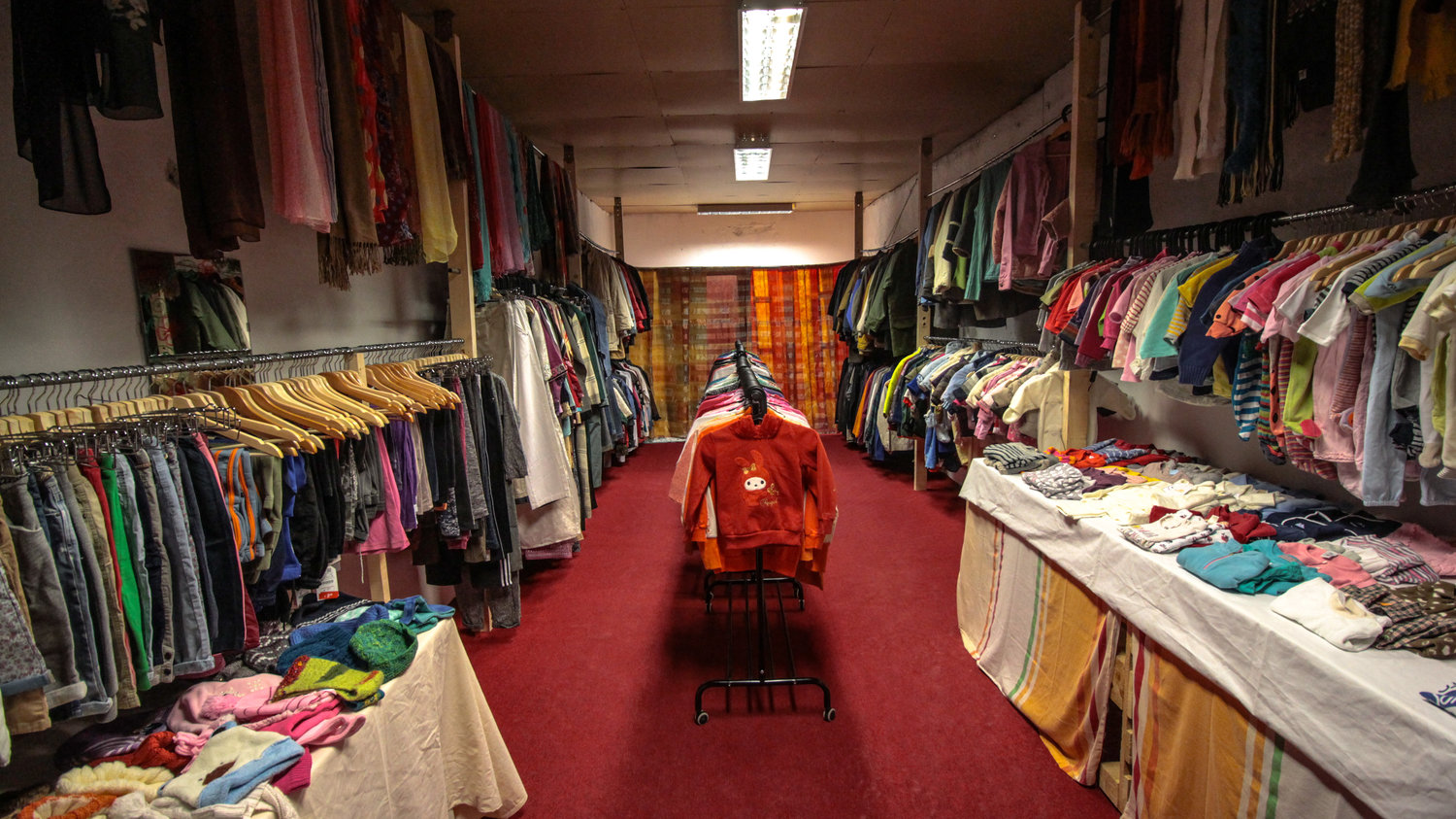 The Clothes Shop stocked and ready for residents to try out, this is how it looked after the guys from  Refugees Foundation, e.V. Support for Refugees on the Ru n came and fitted a ceiling with storage ontop