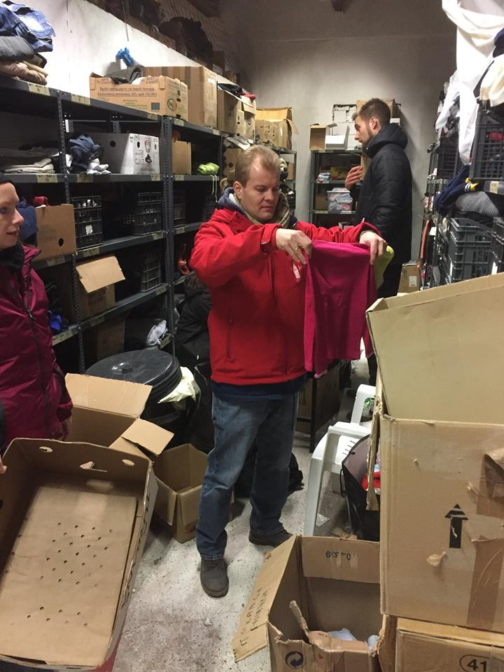 Malte from  Refugees Foundation, e.V. Support for Refugees on the Run sorting clothing
