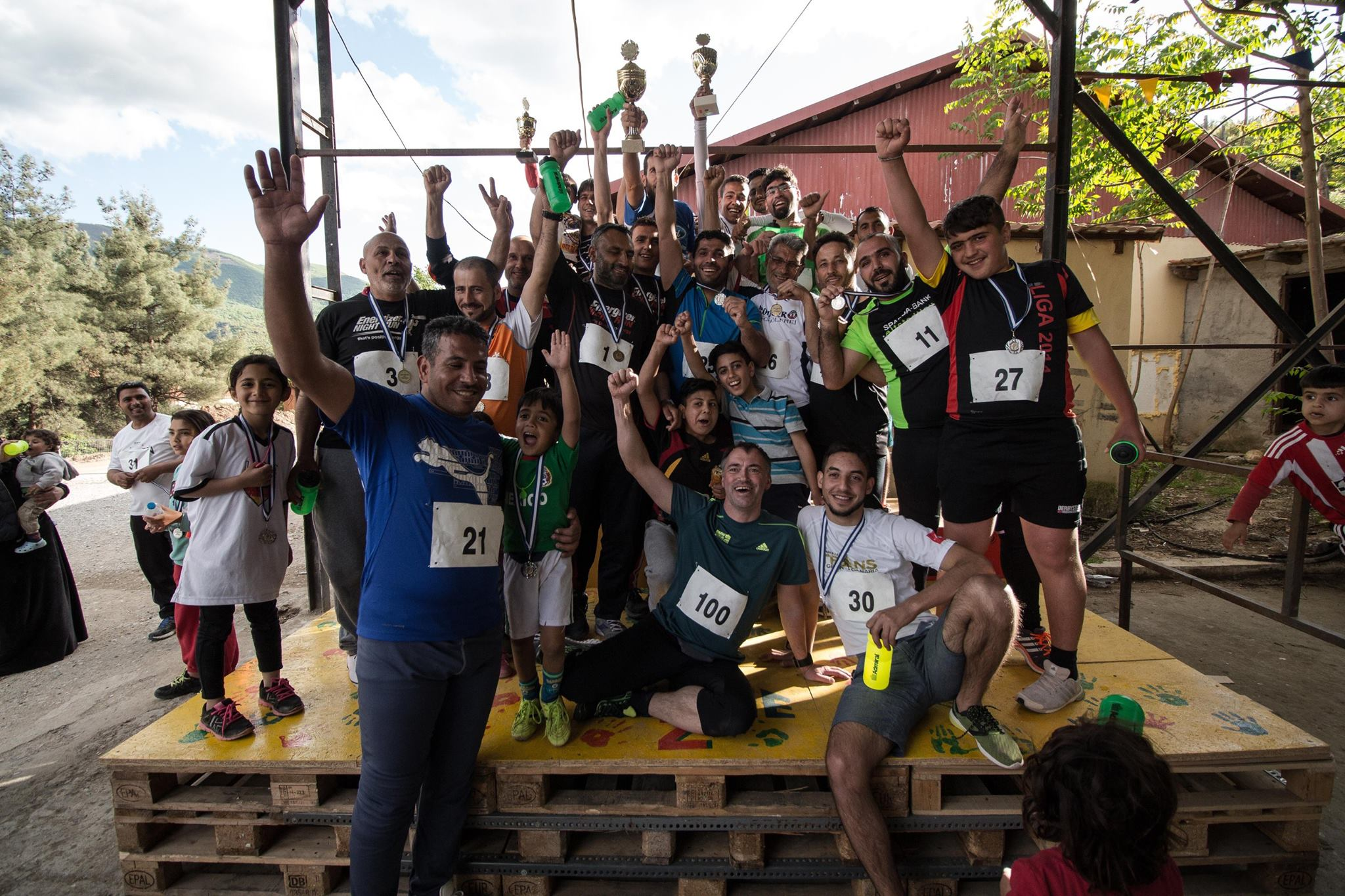Christian Elm-Hartwig held running training for a week. He gave everyone shoes and clothing, and at the end of his stay he held a running race with medals! Presented on the stage built by our volunteers :)