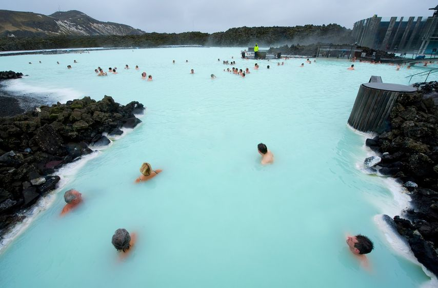 20578388 - reykjavik, iceland - march 08, 2013: people bathing in the blue lagoon, a geothermal bath resort in the south of iceland, a 'must see' by tourists. the water is sourced from a power station nearby.