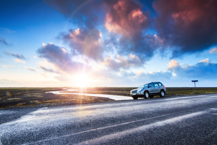 42062296 - a car on the road at sunrise in the beautiful volcanic landscape of myrdalssandur in the southern part of iceland in winter