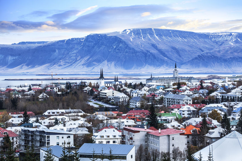 43531817 - beautiful aerial view of reykjavik city, iceland. with harbor and skyline mountains, seen from the perlan the pearl
