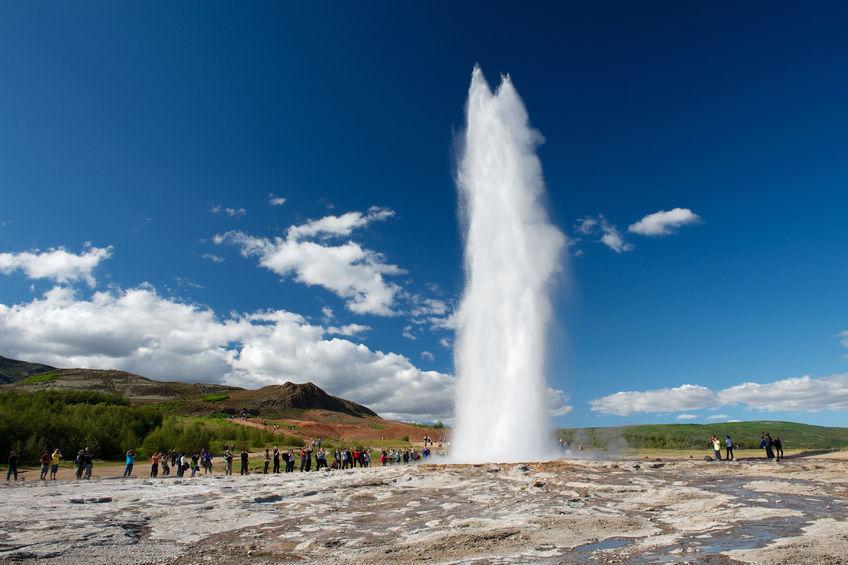 28070068 - impressive eruption of the biggest active geysir, strokkur, with tourists waiting around, golden circle, iceland
