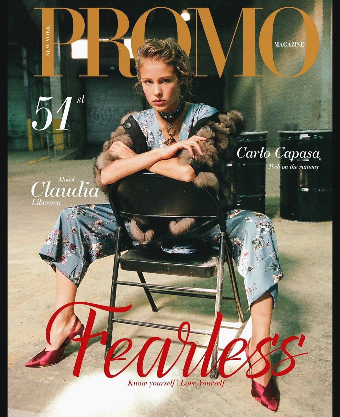 Claudia Liberova sits on a chair which has been turned around, on the cover of Fearless magazine