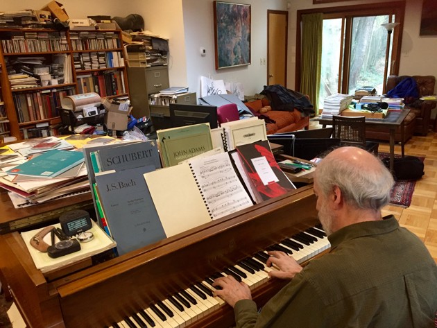 Haskell Small at his piano. Photo by Matthew Schwartz / WAMU.