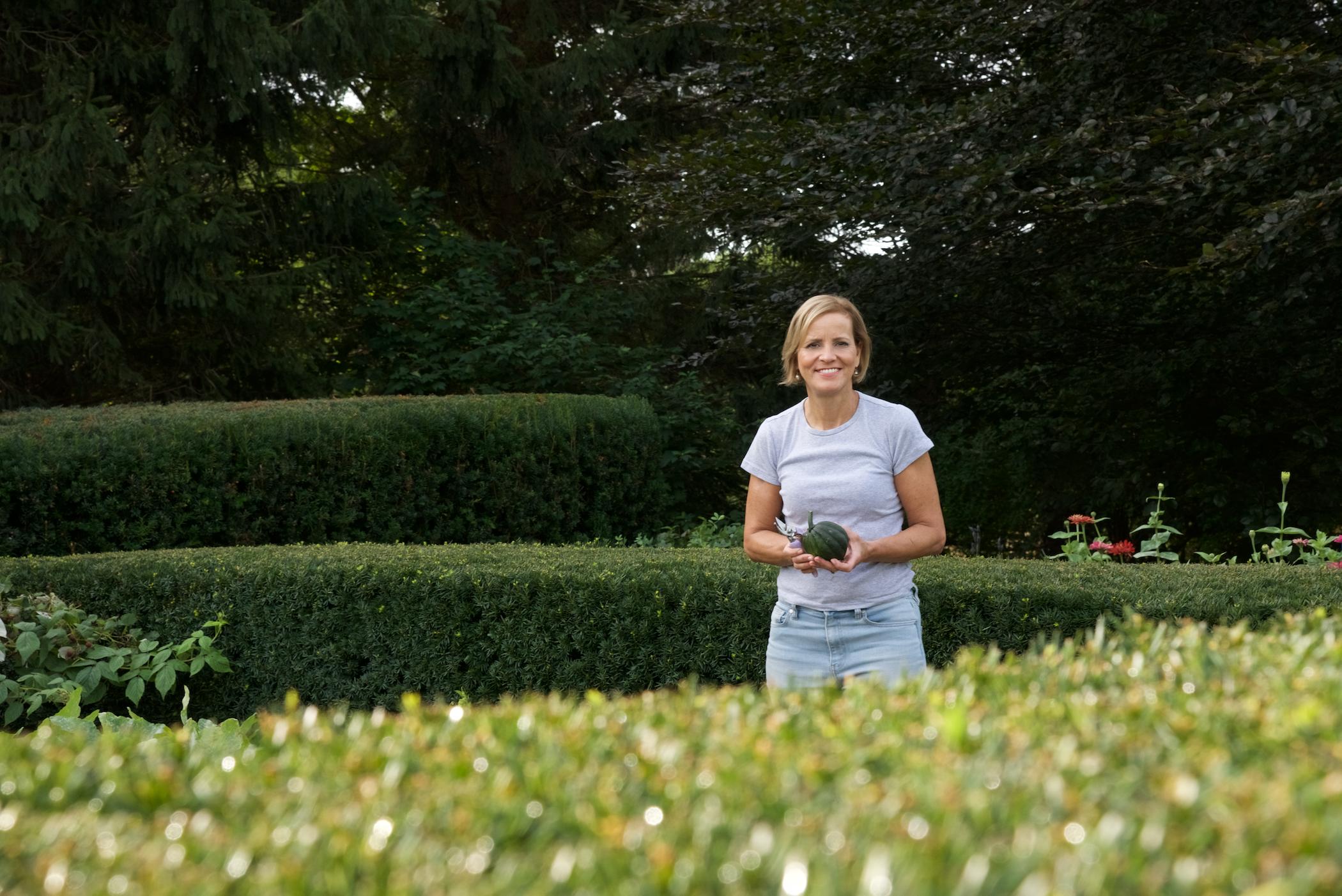 Karen Legan in the garden