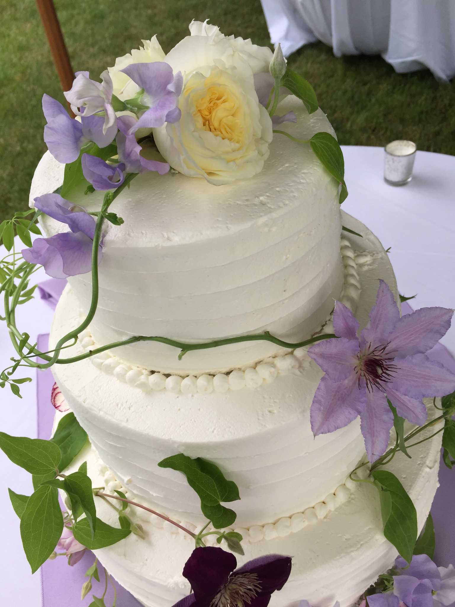 Wedding cake decorated with clematis