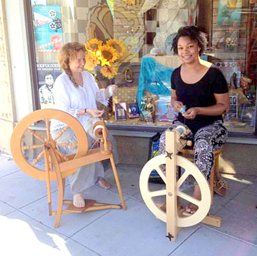 Flo (R) and Mary (L) spinning fiber.
