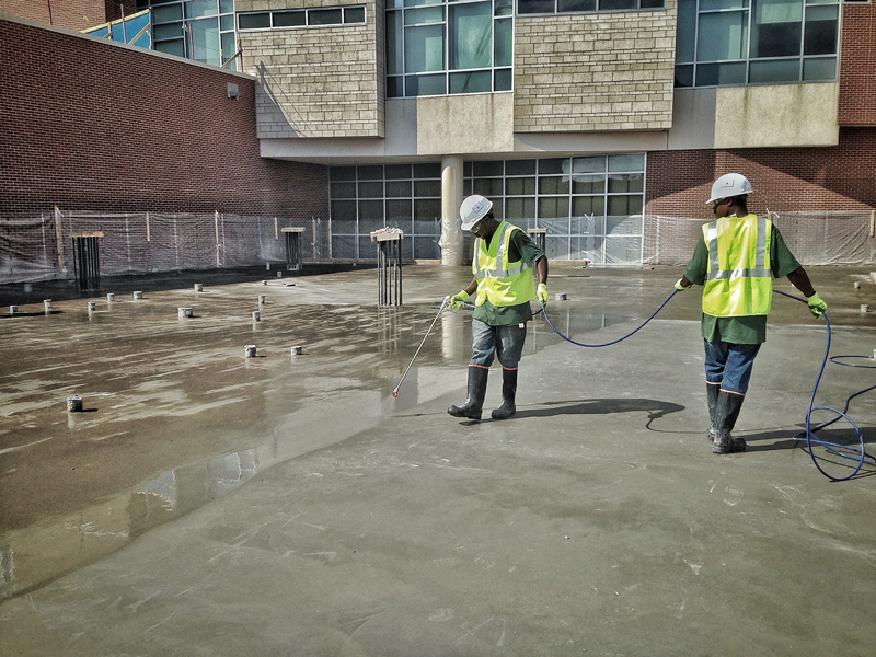 The WCP crew applying the Spray-Lock sealing treatment at one of our client's sites.