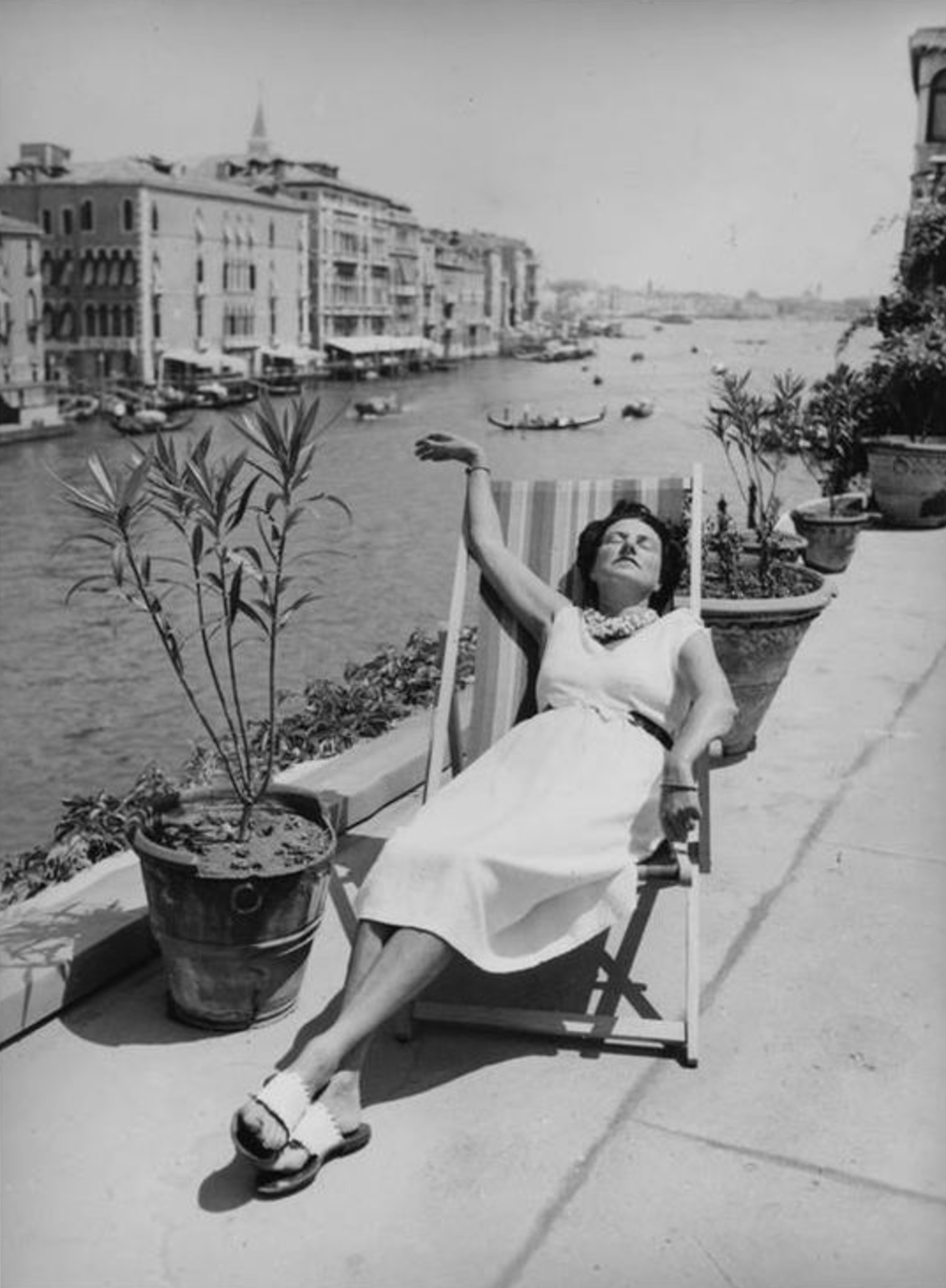 PEGGY GUGGENHEIM on the terrace of her home, the Palazzo Venier dei Leoni in Venice, 1949