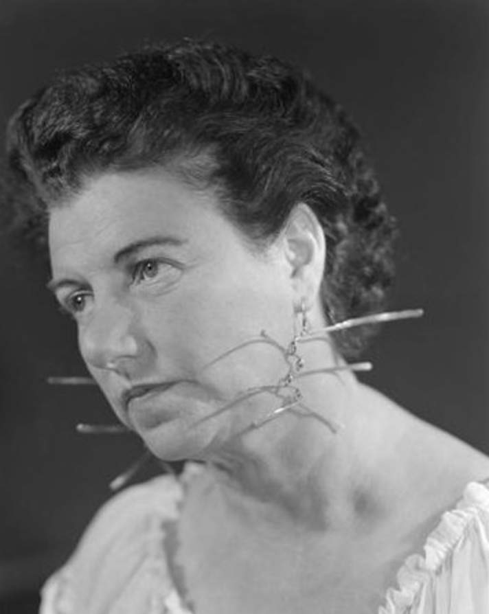 PG with earrings by Alexander Calder