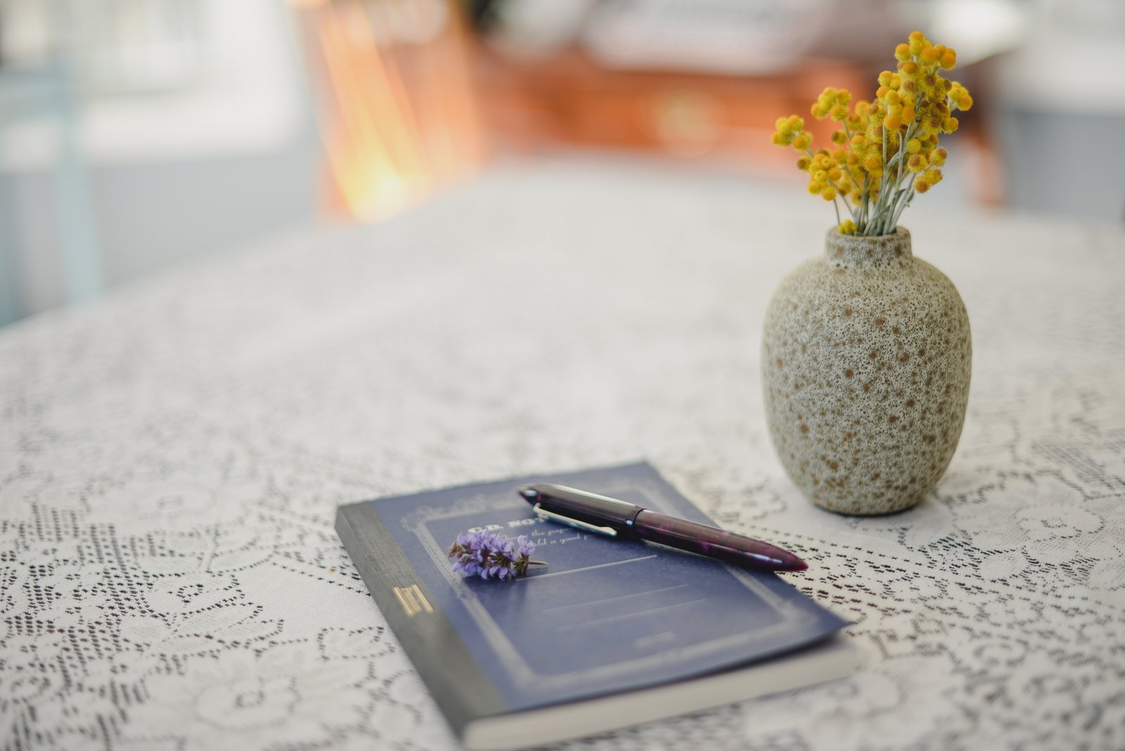 notebook, fountain pen, and flowers