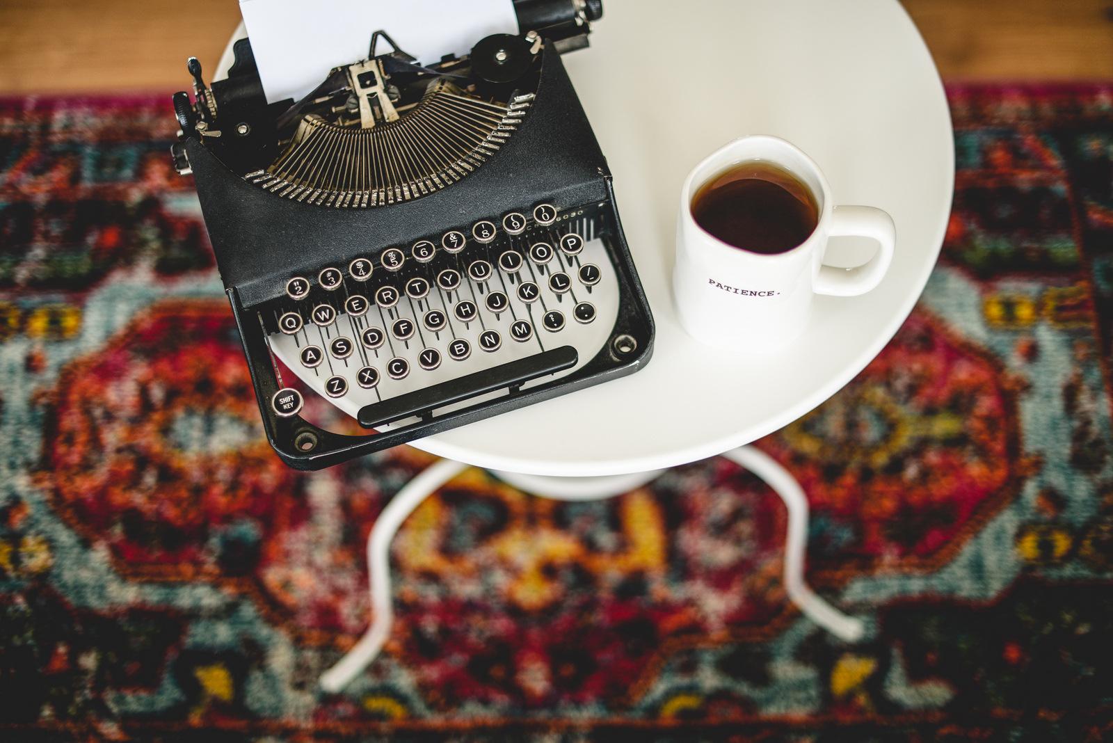 black typewriter and tea
