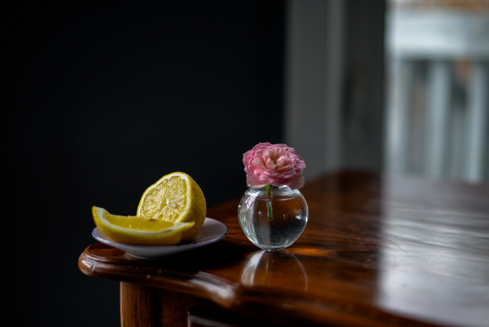 still life with rose and lemon