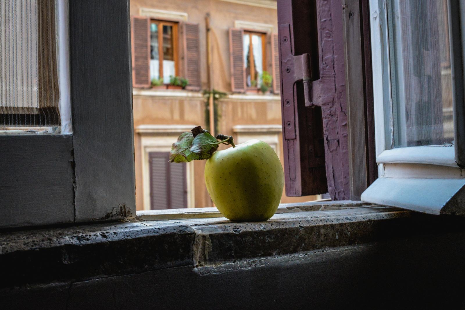 apple on a windowsill