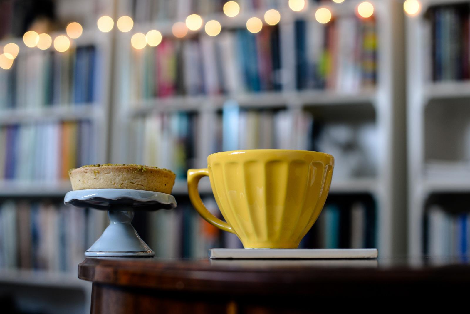 yellow mug with books