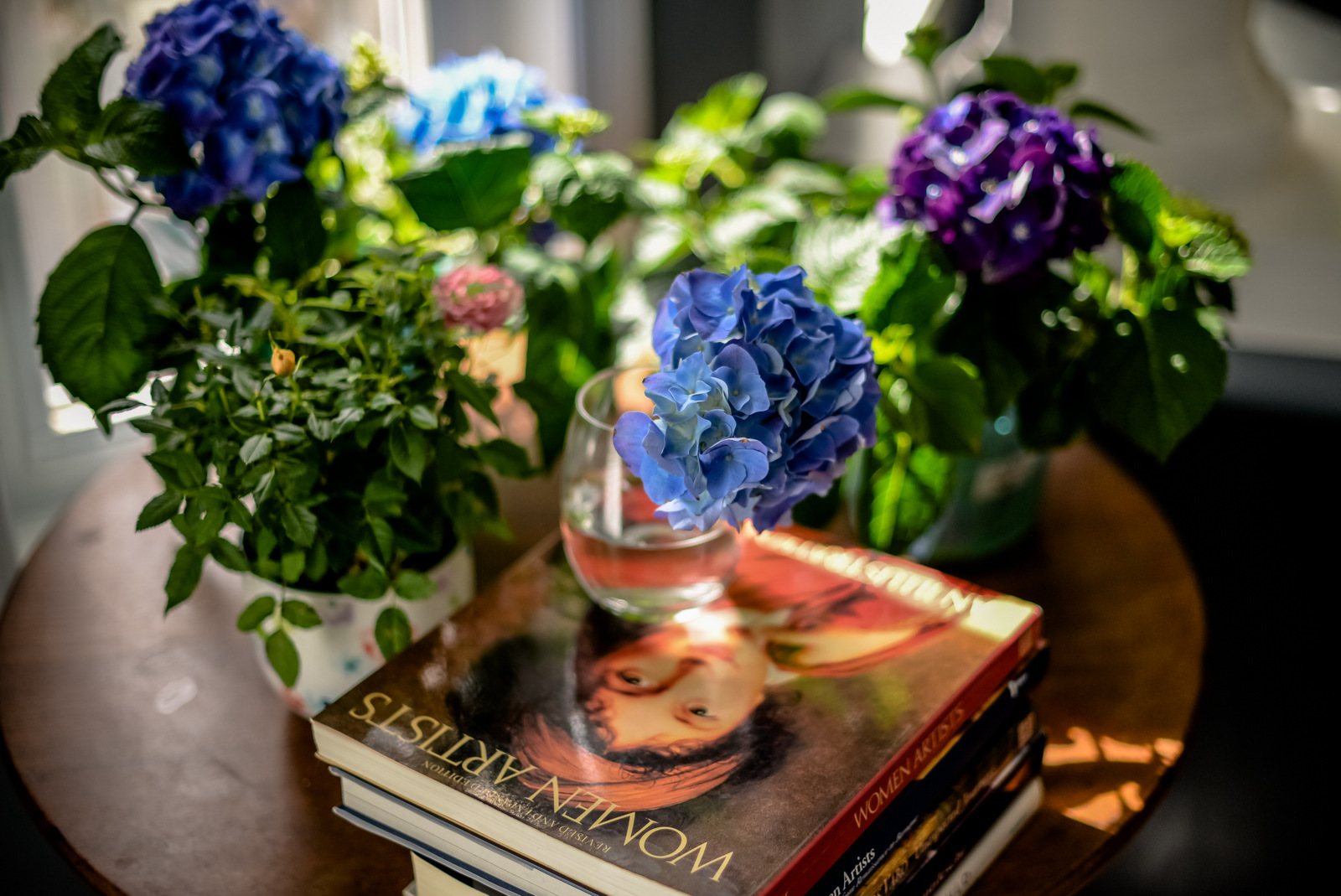 blue hydrangea and books