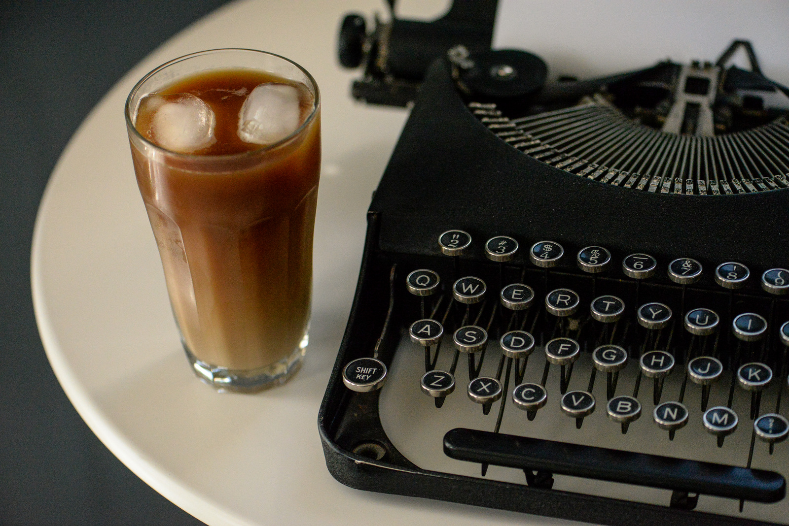 typewriter and iced coffee