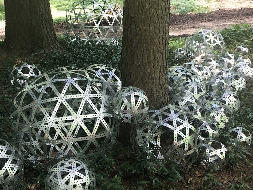 Metheny_Trees and Spheres_2017(Detail)_perforated metal strapping,screws, grommets_(aprox.) 40_H x 216_W x 216_D copy.jpg