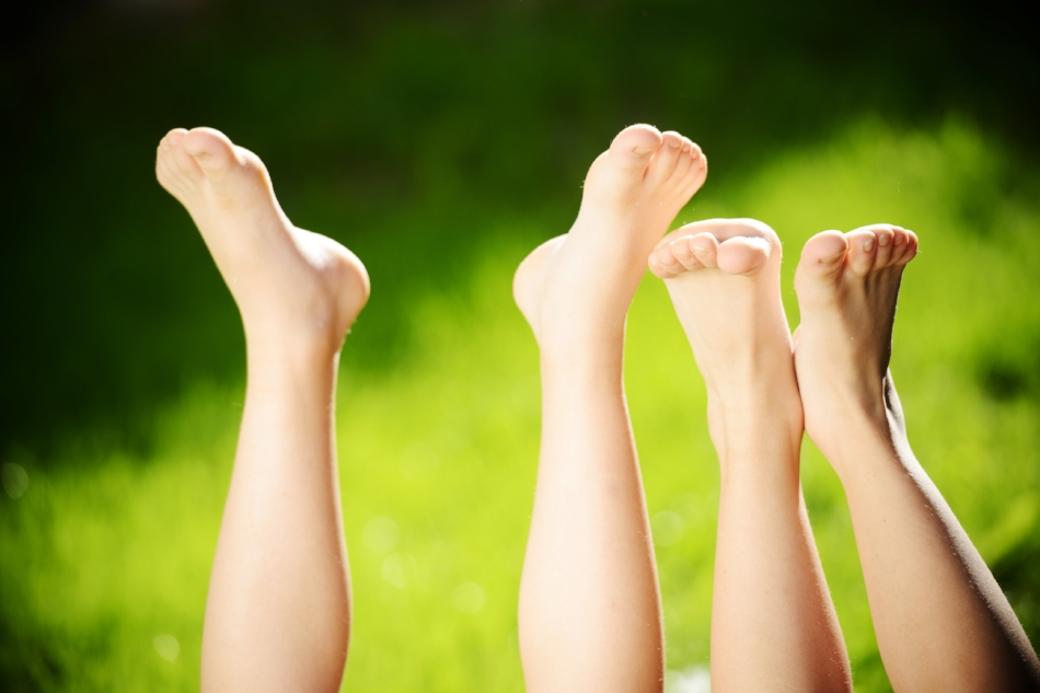 Kids with legs in air at park.jpg
