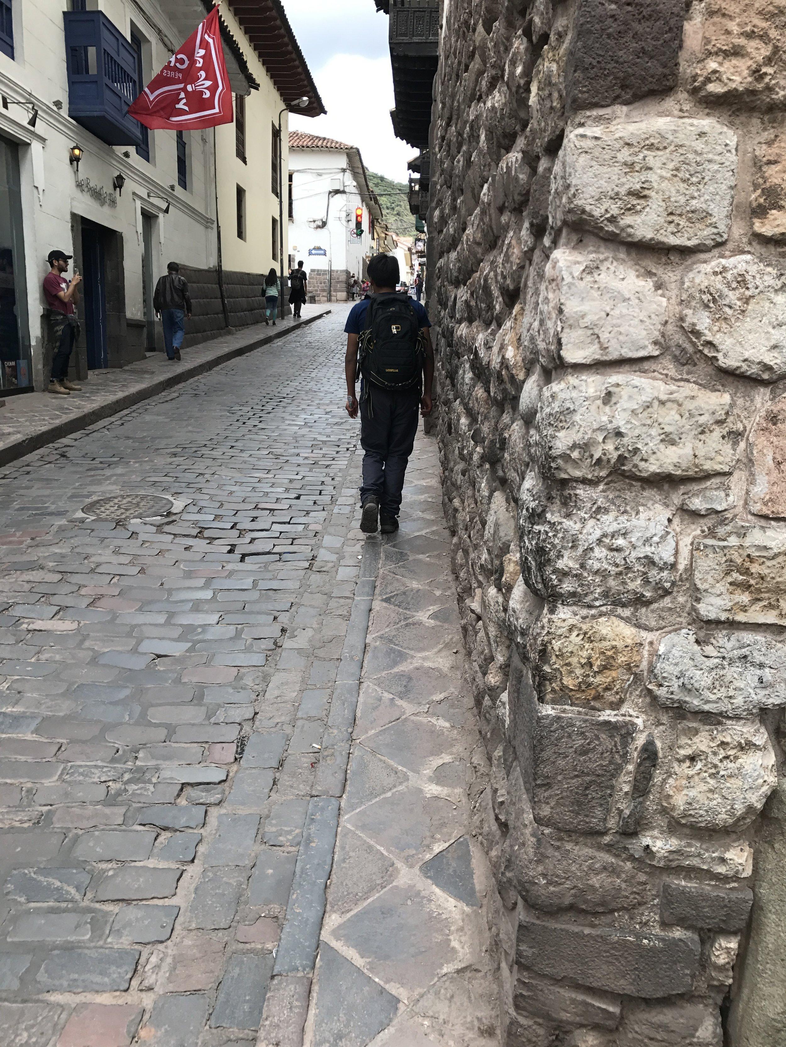 Narrow streets and sidewalks in Cusco.