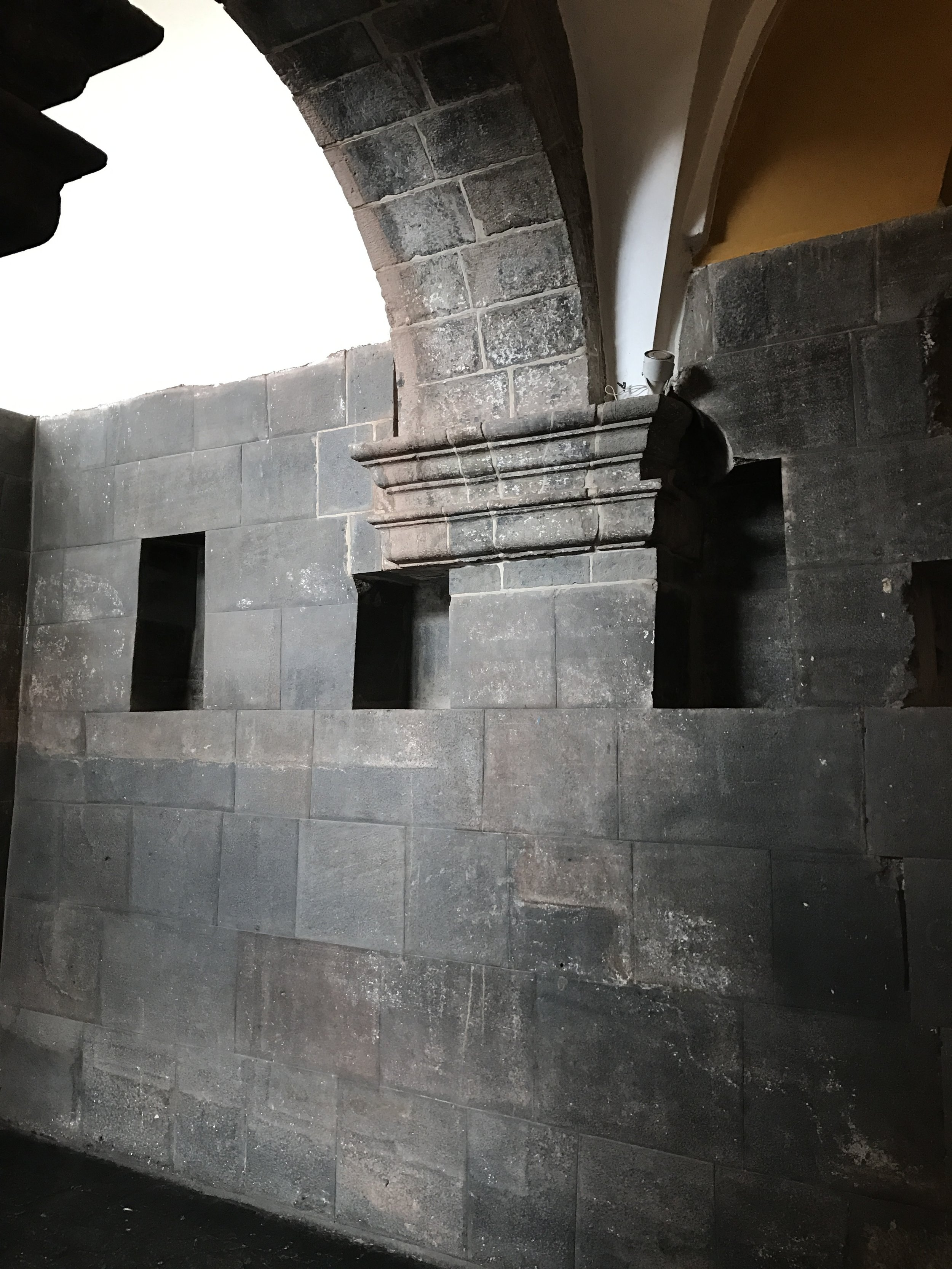 Wall of the Sun Temple serves as foundation for an arch.