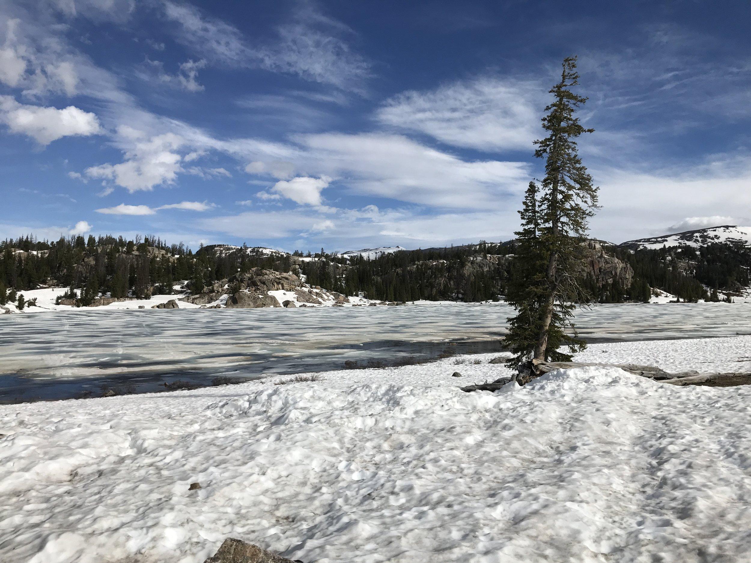Partially frozen lake near the pass.