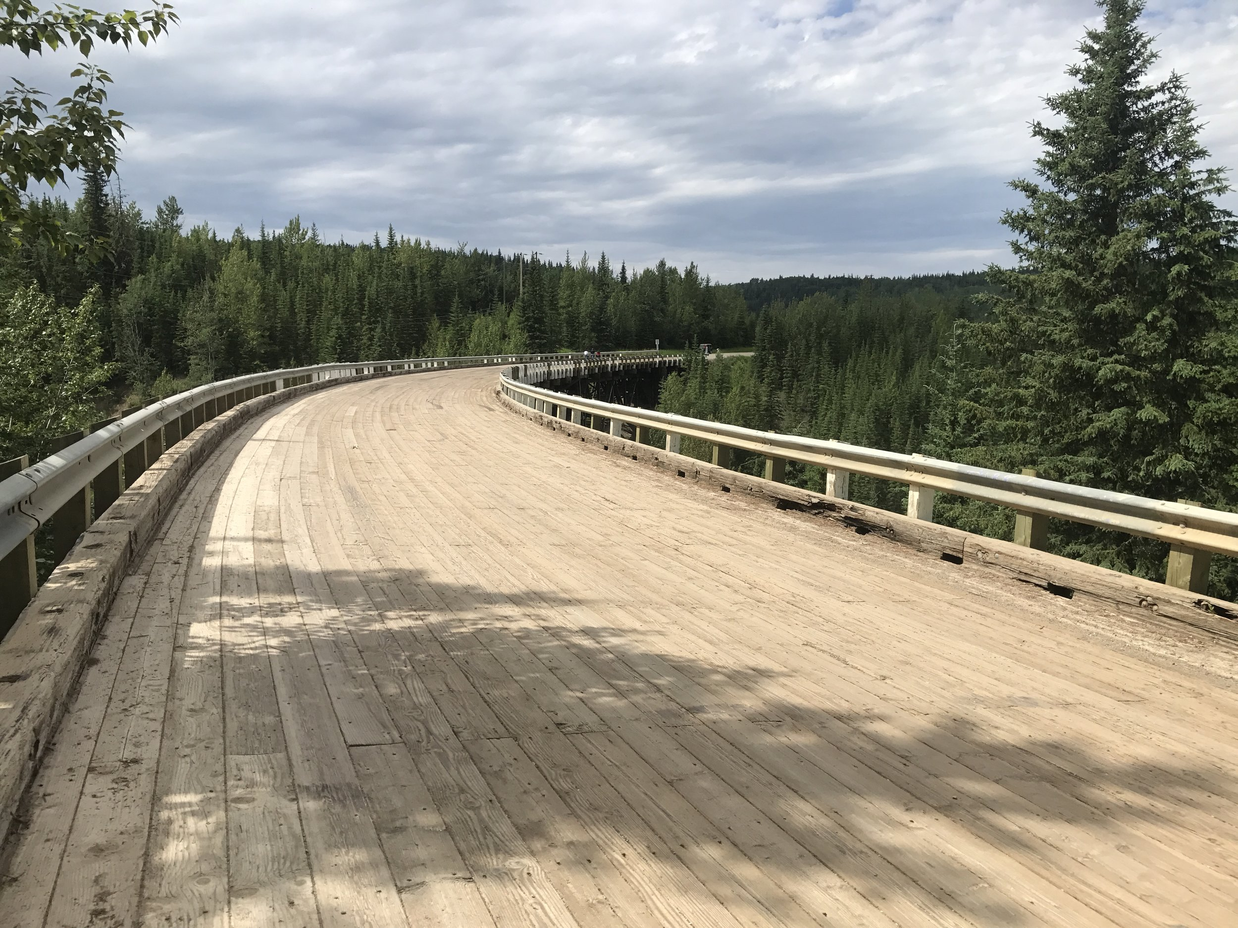 Notice the surface is made of wood and the bridge is curved.