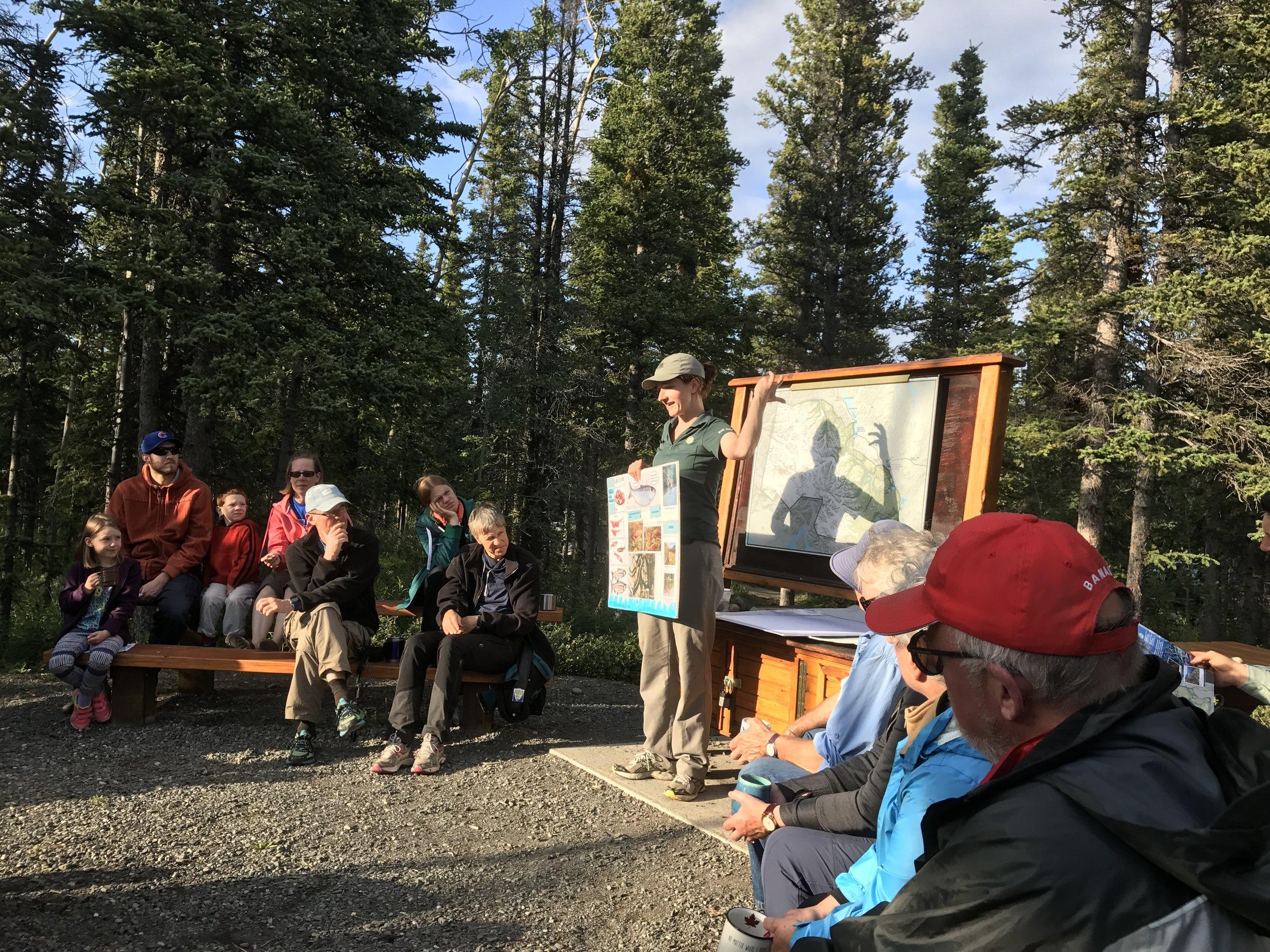 Ranger explaining the history and lifecycle of the  kokanee salmon.