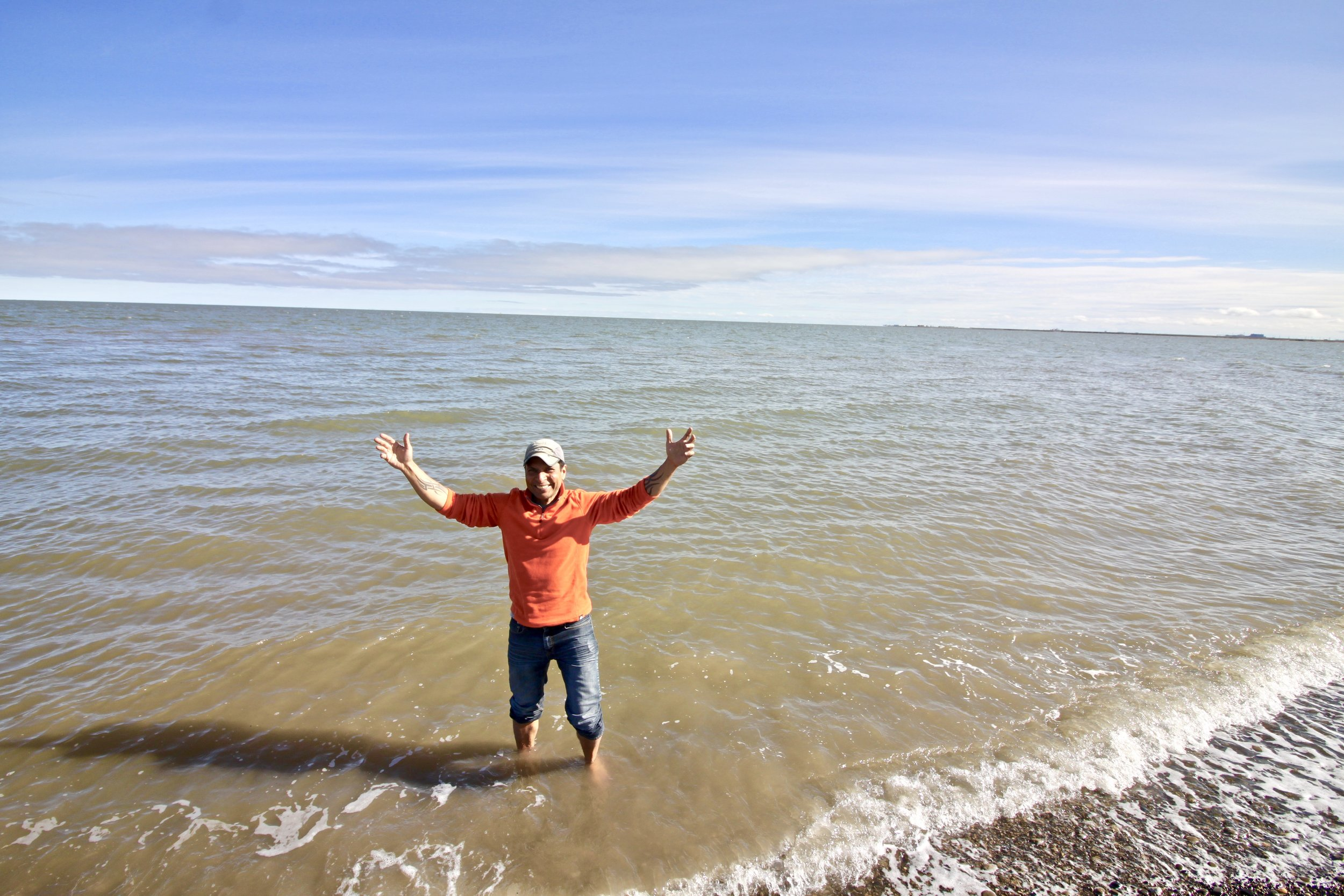 Dipping my toes in the Arctic Ocean.